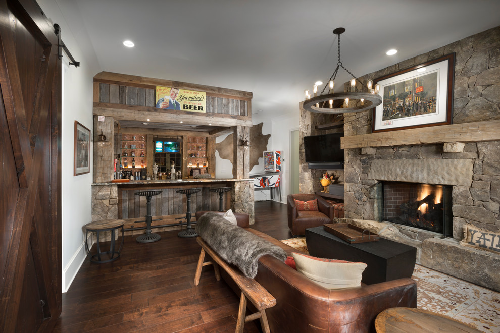 Example of a mountain style home bar design in Other