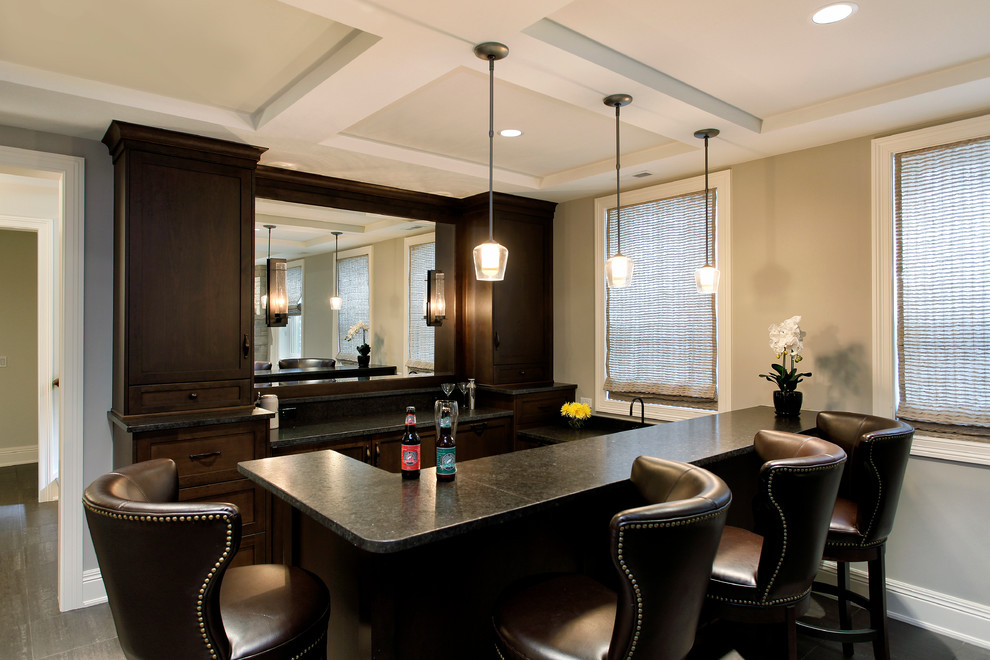 Seated home bar - craftsman u-shaped dark wood floor seated home bar idea in Chicago with recessed-panel cabinets and dark wood cabinets