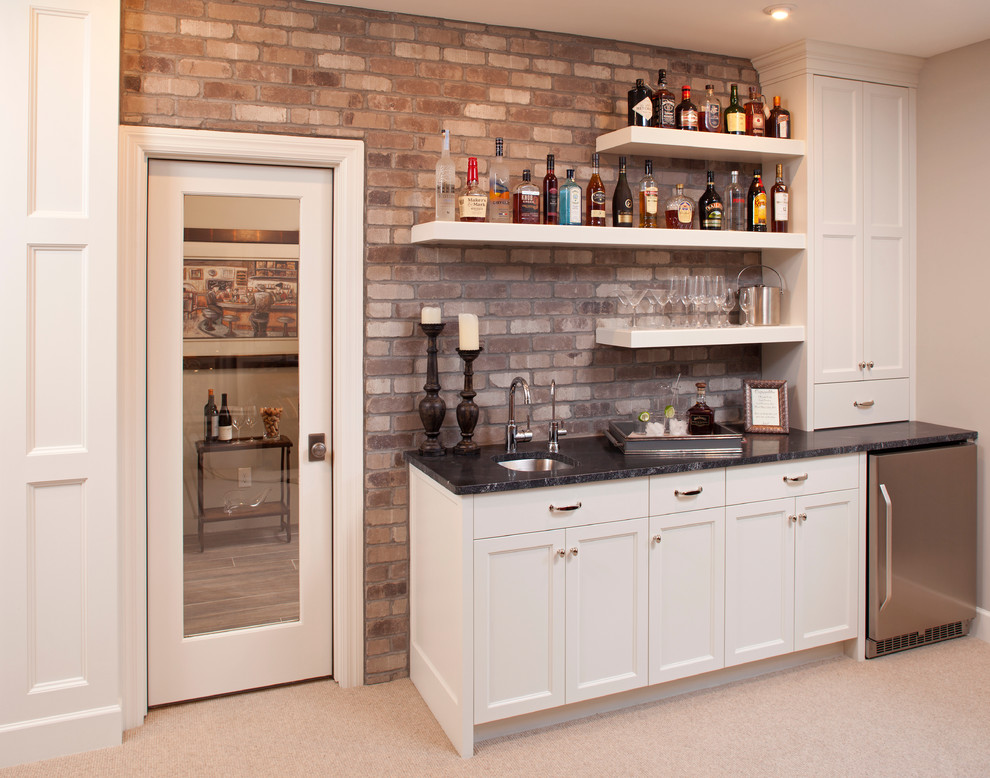 Inspiration for a timeless single-wall carpeted and beige floor wet bar remodel in Minneapolis with an undermount sink, recessed-panel cabinets and white cabinets