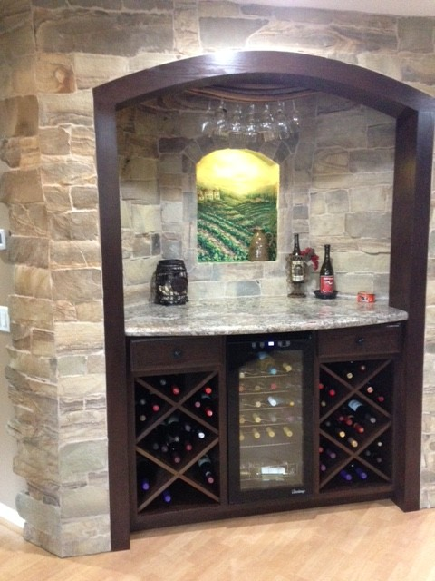 Example of a small mountain style single-wall light wood floor and beige floor wet bar design in Orange County with open cabinets, dark wood cabinets, granite countertops, multicolored backsplash and stone tile backsplash