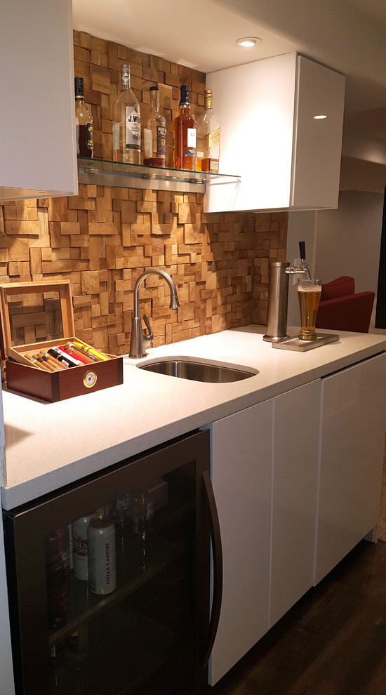 Inspiration for a small contemporary galley vinyl floor and brown floor wet bar remodel in Toronto with an undermount sink, flat-panel cabinets, white cabinets, quartzite countertops, brown backsplash, wood backsplash and white countertops