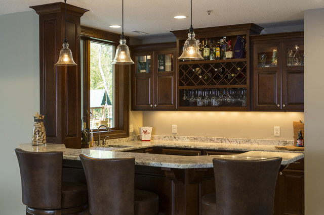 Example of a mid-sized classic u-shaped porcelain floor wet bar design in Other with an undermount sink, raised-panel cabinets, dark wood cabinets, granite countertops and multicolored backsplash