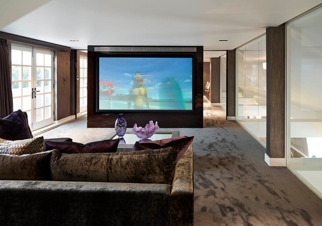 Photo of a contemporary home cinema in London with brown walls, carpet, a projector screen and brown floors.