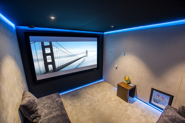 Small Trendy Enclosed Carpeted Home Theater Photo In London With Beige Walls And A Projector Screen