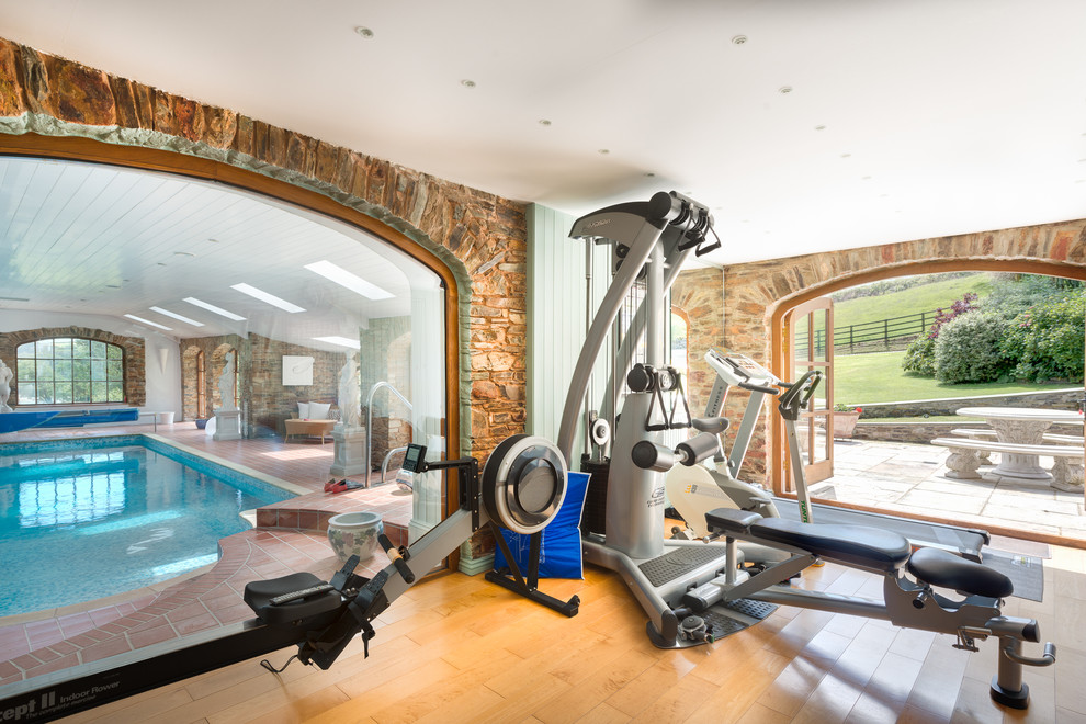 Example of a mid-sized cottage medium tone wood floor multiuse home gym design in Devon