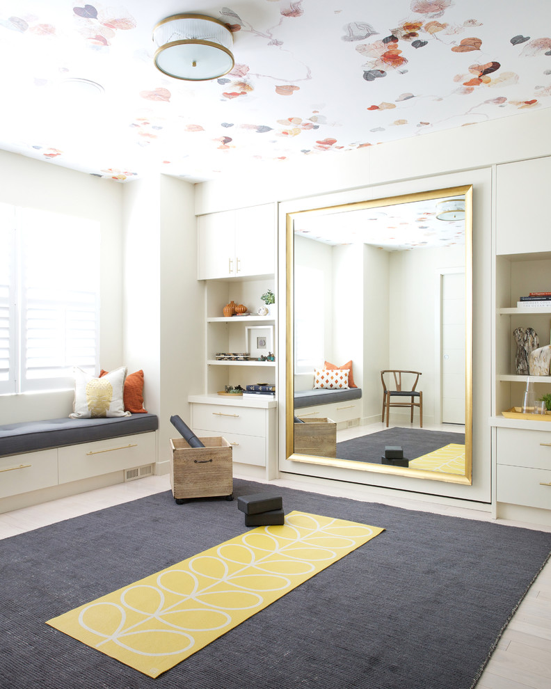 Example of a transitional beige floor home yoga studio design in Calgary with beige walls