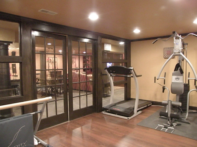 basement home gym area design with tv room home design elements