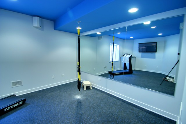 Basement exercise room with mirrored wall