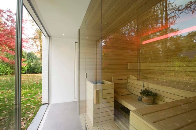 Bespoke sauna with glass fronting looking out onto garden bespoke sauna with glass fronting looking out onto garden contemporary home gym planetlyrics Image collections