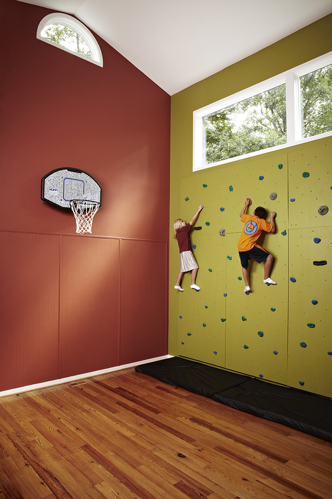 Inspiration for a mid-sized transitional medium tone wood floor home climbing wall remodel in DC Metro with green walls