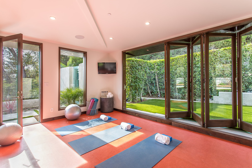 Inspiration for a mid-sized contemporary red floor home yoga studio remodel in Los Angeles with white walls