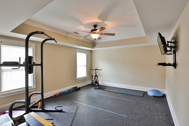 Example of a mid-sized classic multiuse home gym design in Atlanta with beige walls