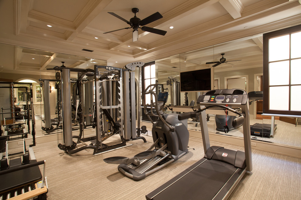 Example of a mid-sized tuscan carpeted and beige floor home gym design in Orange County