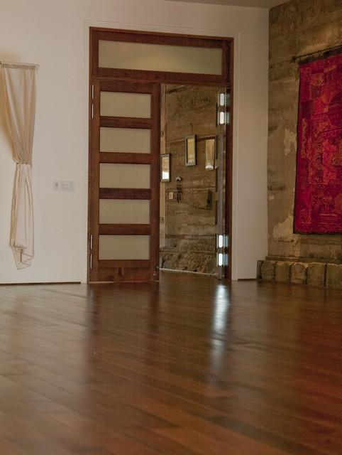Double doors eclectic-home-gym
