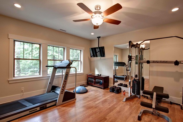 Exercise room traditional home gym by for Home gym room