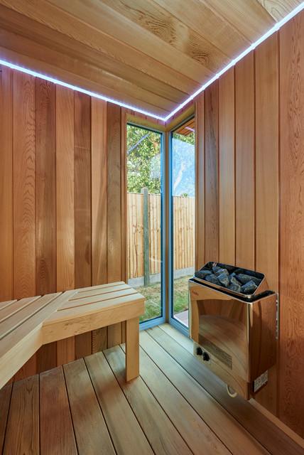 Garden space with sauna shower room and sunken trampoline