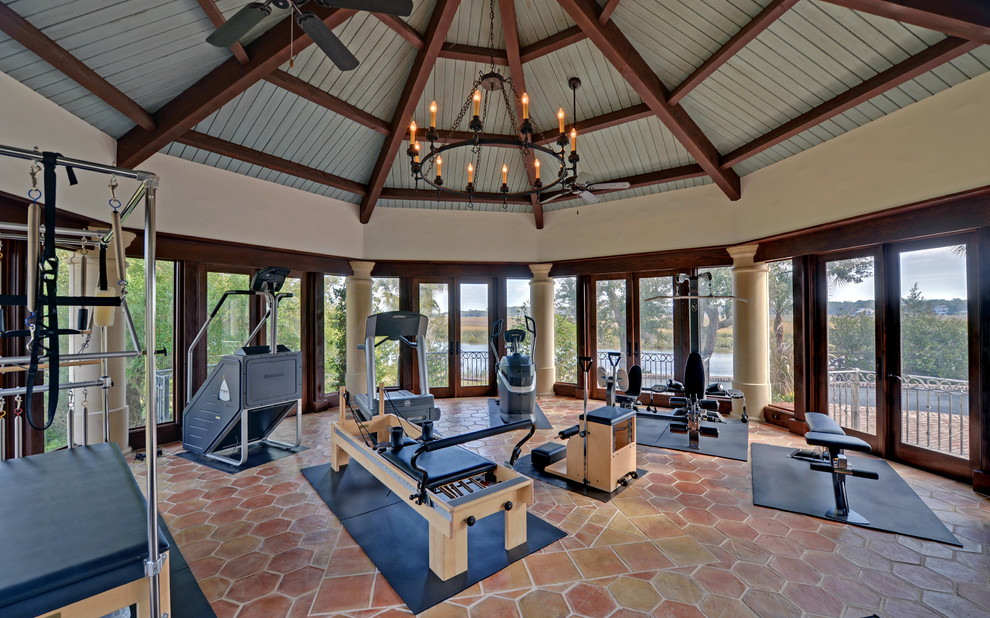 Inspiration for a large mediterranean terra-cotta tile and red floor multiuse home gym remodel in Atlanta with beige walls