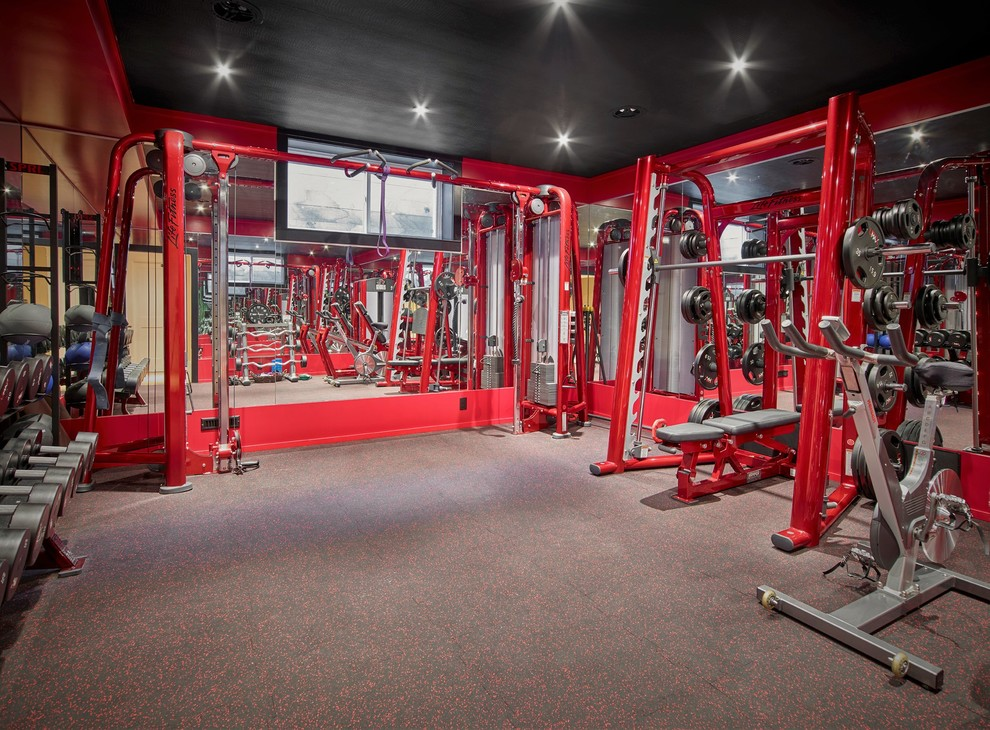 Inspiration for a large modern gray floor home weight room remodel in Calgary with red walls