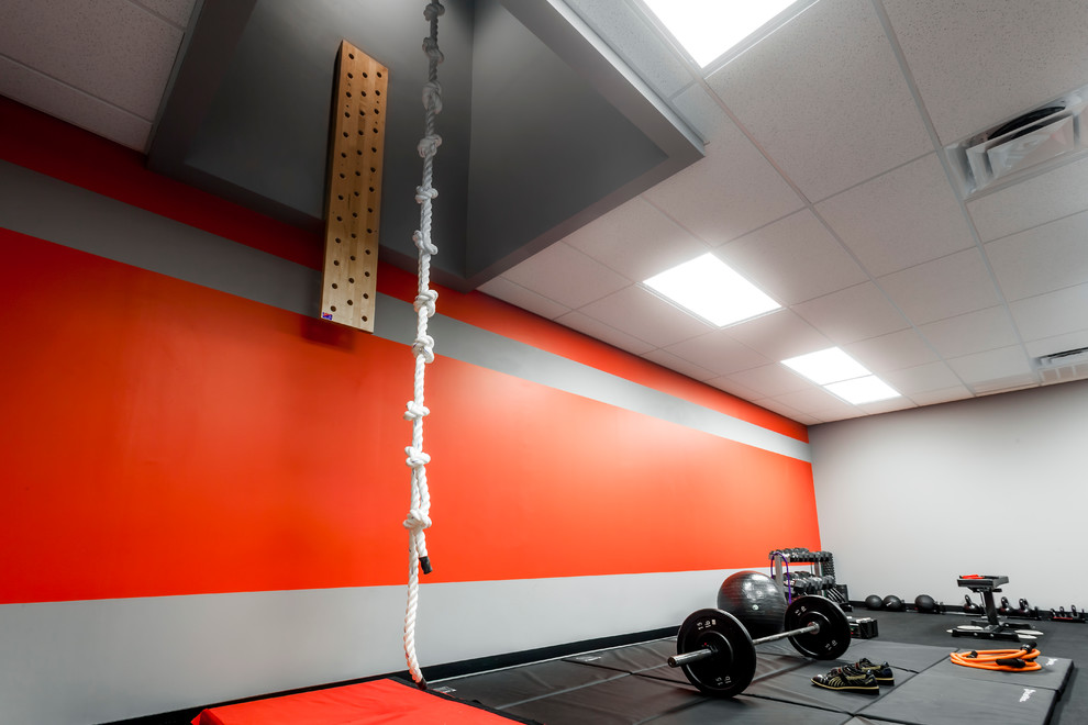Inspiration for a large modern gray floor home climbing wall remodel in Orlando with red walls