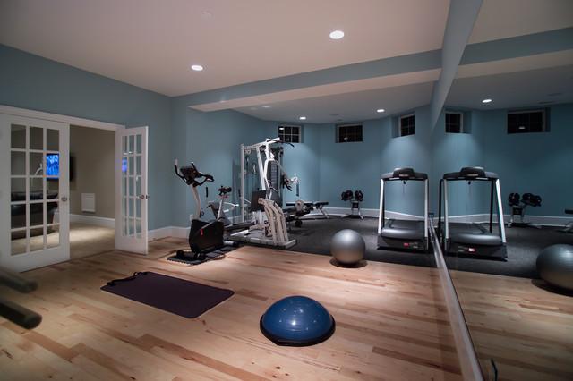 Home basement gymnasium and dance studio moderno