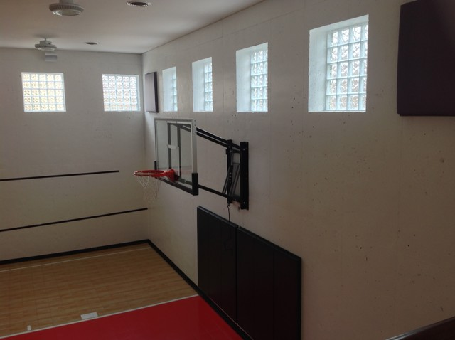 Home gym basketball court with glass block windows for Building a basketball court at home