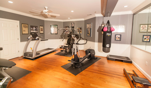 Home gym with large mirror and bright lighting traditional