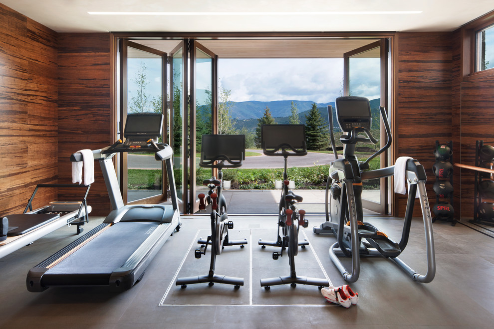 Home gym - huge contemporary vinyl floor and gray floor home gym idea in Denver with brown walls