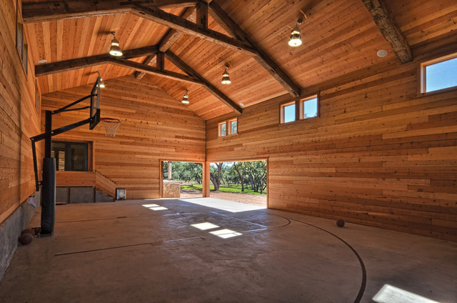 Llano ranch rustic home gym austin by cornerstone for How much does it cost to build a sport court