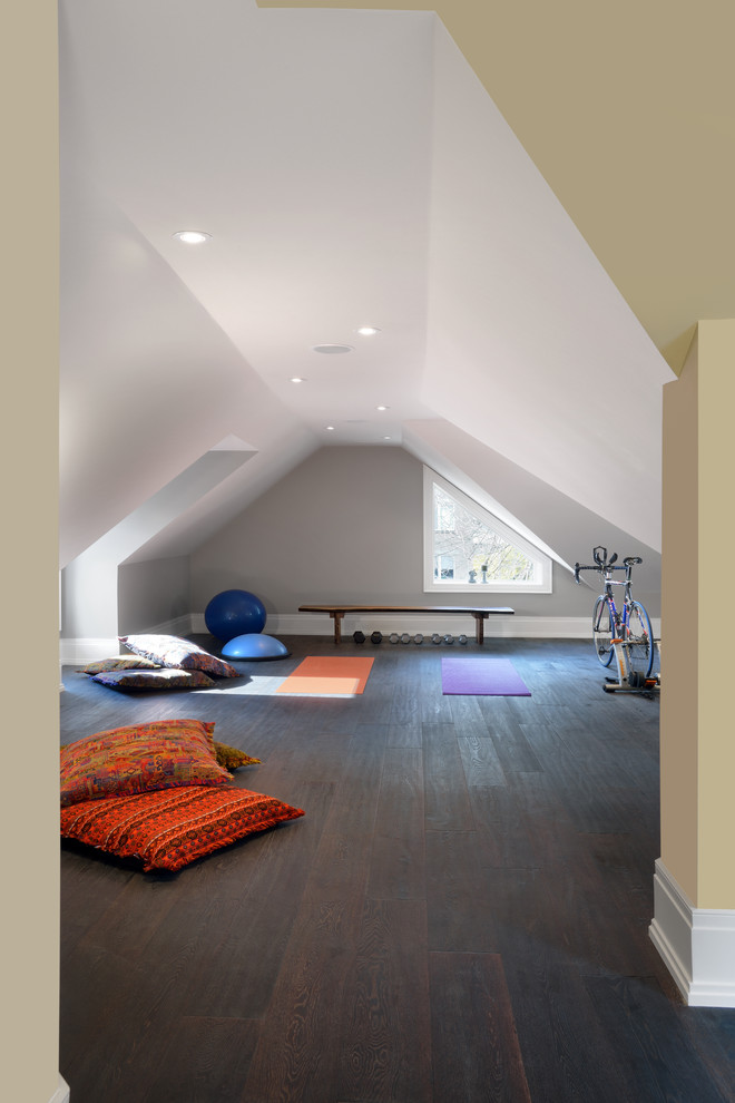 Inspiration for a mid-sized timeless dark wood floor and brown floor home yoga studio remodel in Toronto with gray walls