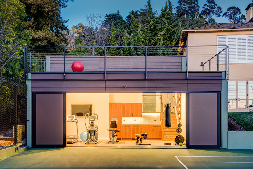 Multiuse home gym - mid-sized contemporary medium tone wood floor multiuse home gym idea in San Francisco with white walls