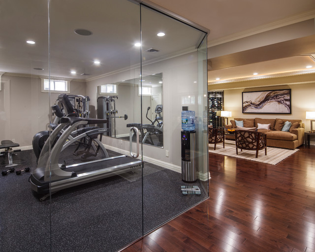 Modern basement home gym area design with tv room inside