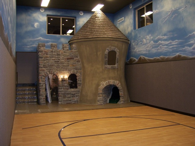 Under garage basketball court play castle traditional for House plans with indoor sport court