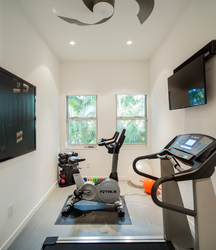 Multiuse home gym - small vinyl floor and gray floor multiuse home gym idea in Tampa with white walls