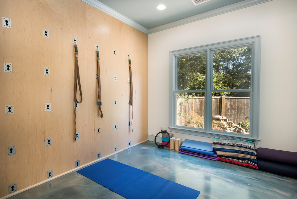 Inspiration for a small coastal concrete floor and blue floor home gym remodel in Atlanta
