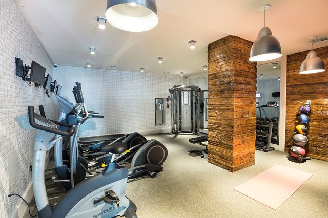 home gym lighting. example of a trendy beige floor multiuse home gym design in new york lighting l