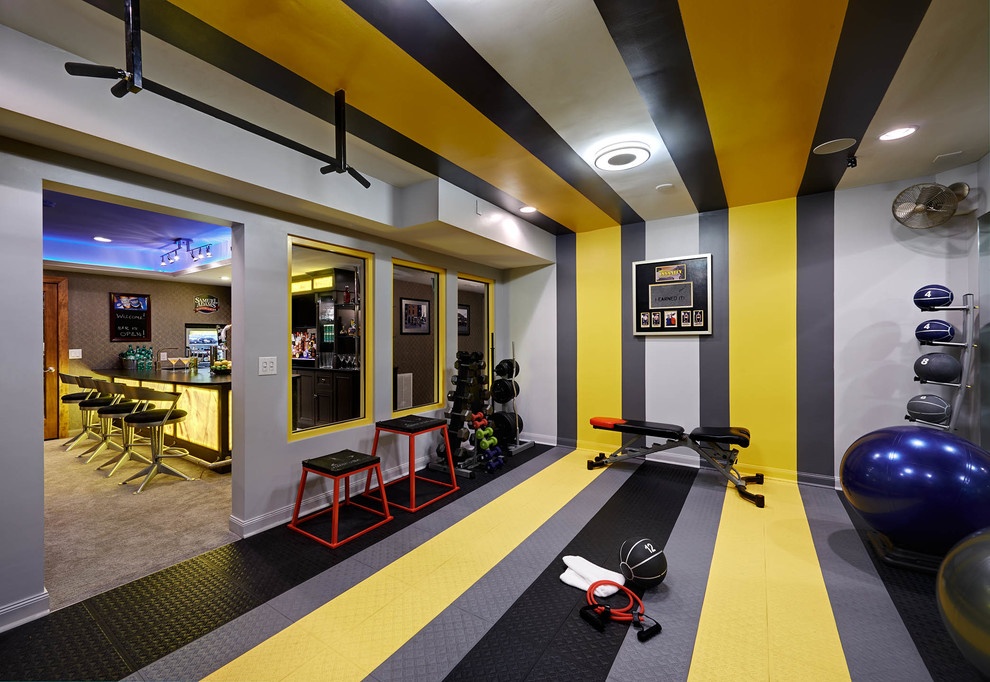 Home weight room - contemporary multicolored floor home weight room idea in Charlotte with multicolored walls