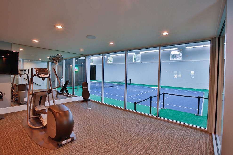 Inspiration for a large timeless home weight room remodel in Salt Lake City with gray walls