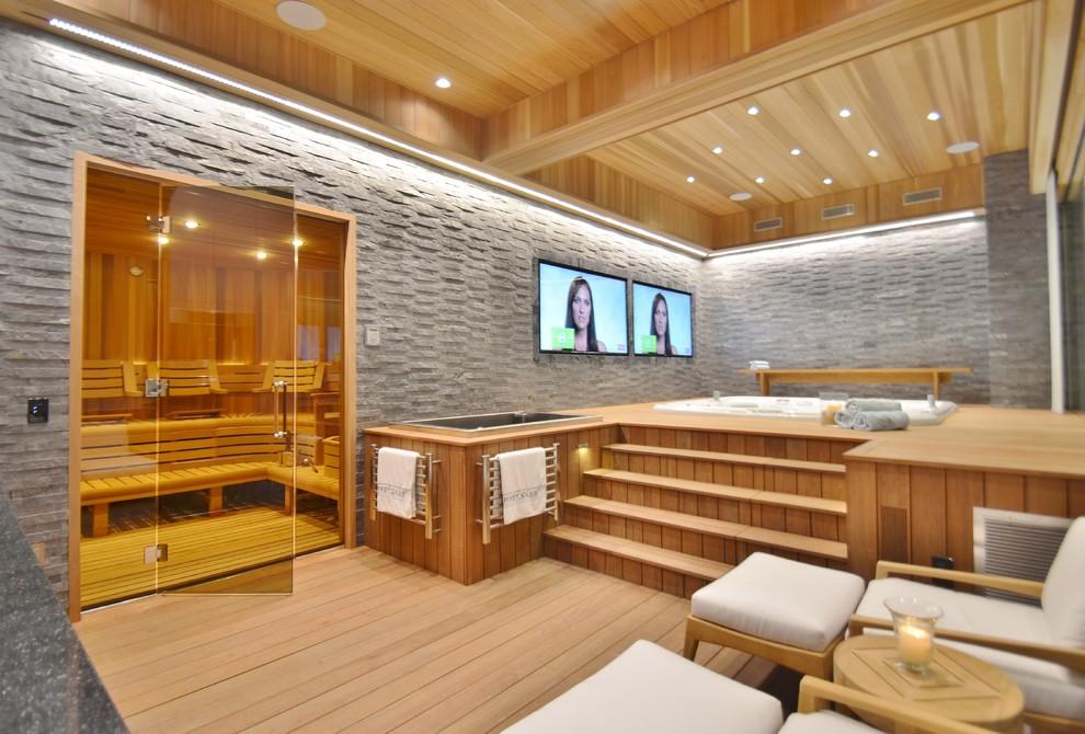 Huge trendy light wood floor home gym photo in New York