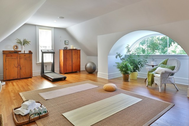 Example of a classic home yoga studio design in New York with white walls
