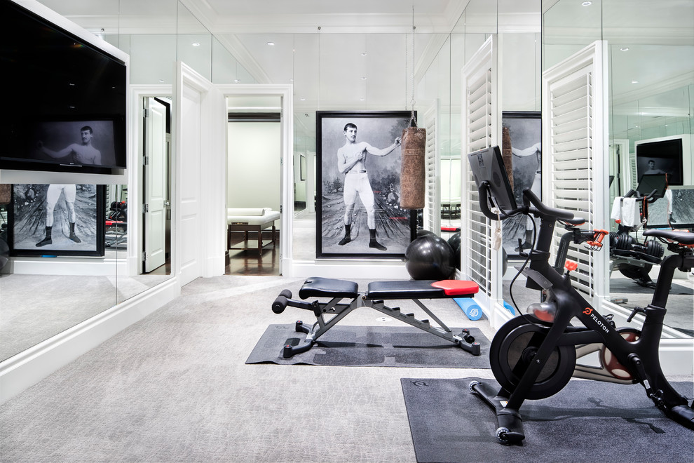 Example of a large transitional carpeted and gray floor home weight room design in Austin with white walls