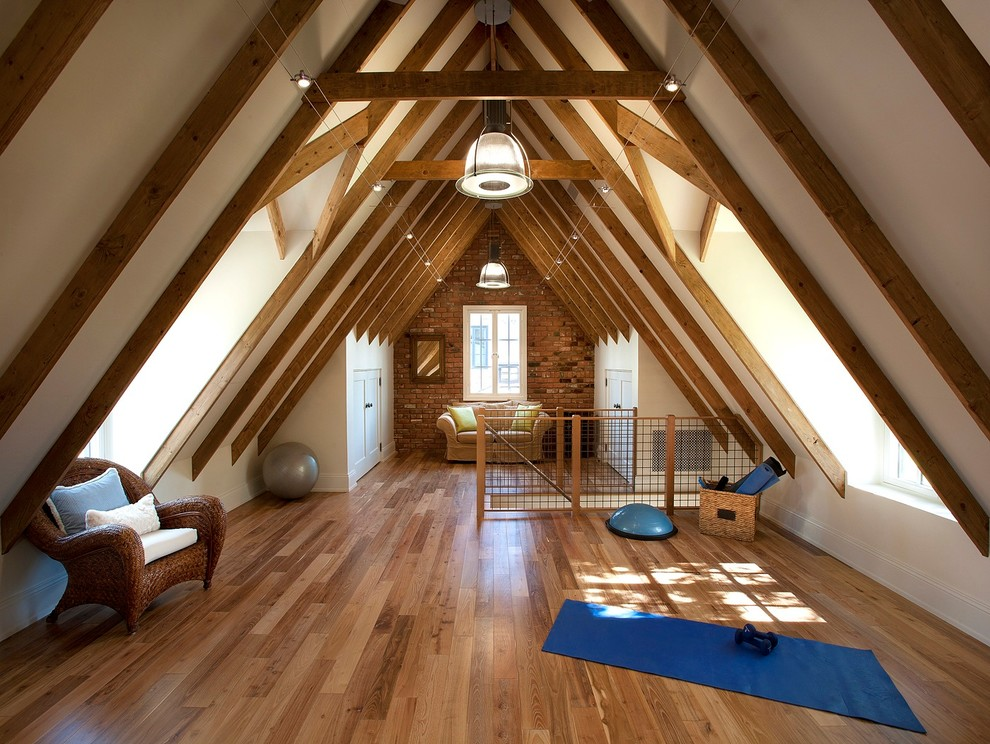 Example of a large transitional medium tone wood floor home yoga studio design in Phoenix with white walls