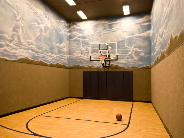 Under garage basketball court traditional home gym for Indoor basketball court plans