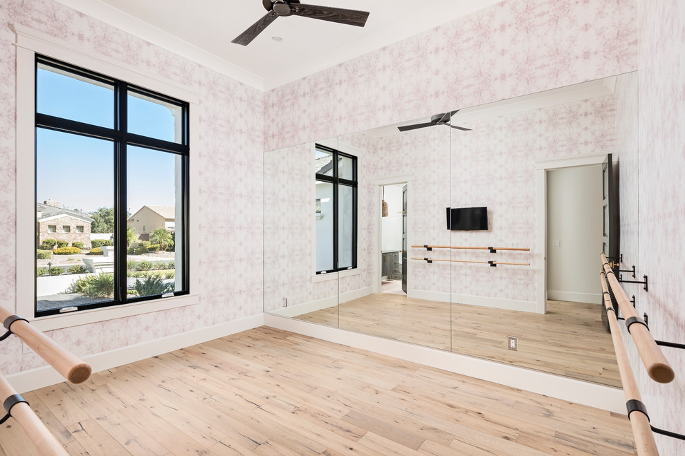 Home gym - transitional light wood floor and beige floor home gym idea in Phoenix with pink walls