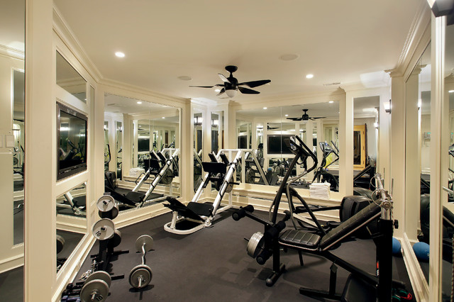 Home weight room - mediterranean gray floor home weight room idea in Chicago with beige walls