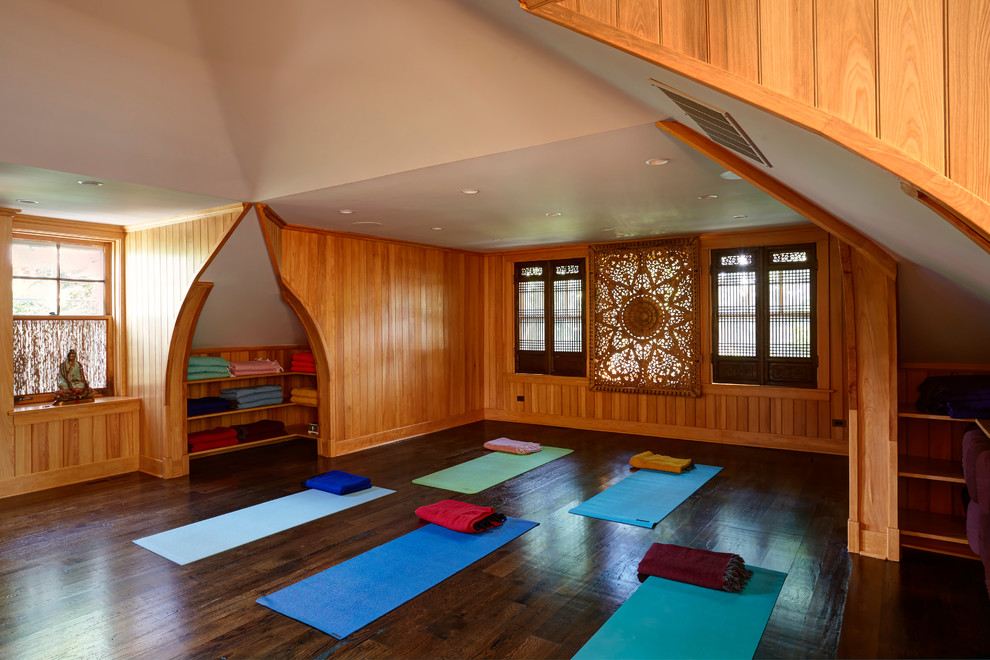 Example of a mid-sized asian dark wood floor and brown floor home yoga studio design in Chicago with brown walls