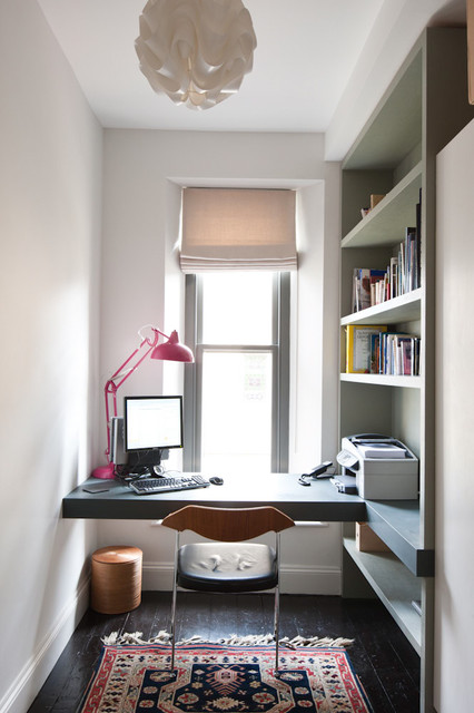 Contemporary home office and library in Other with a built-in desk.