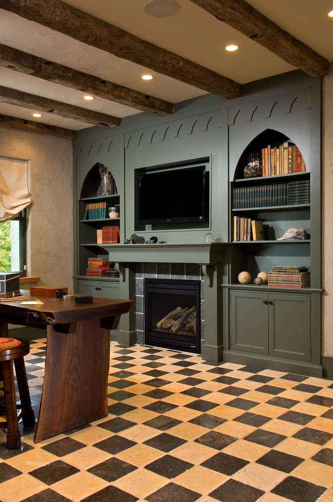 Inspiration for a mediterranean freestanding desk multicolored floor home office remodel in New York with a standard fireplace and a tile fireplace