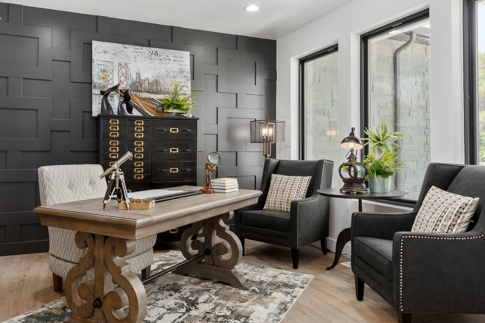 Home office - transitional freestanding desk light wood floor and beige floor home office idea in Salt Lake City with white walls