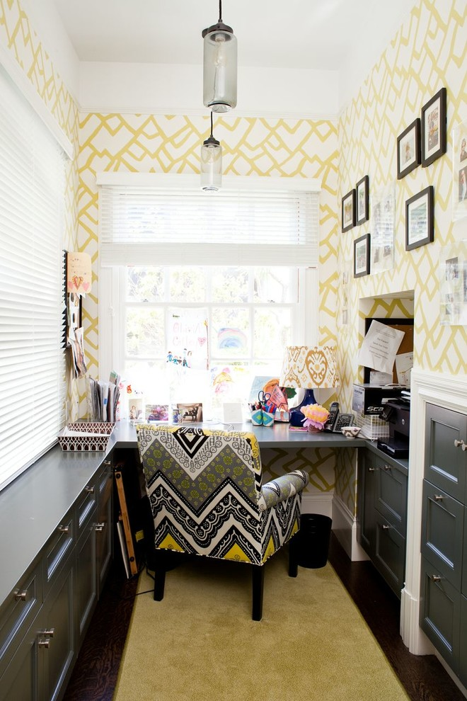 Inspiration for a small transitional built-in desk study room remodel in Jacksonville with multicolored walls and no fireplace