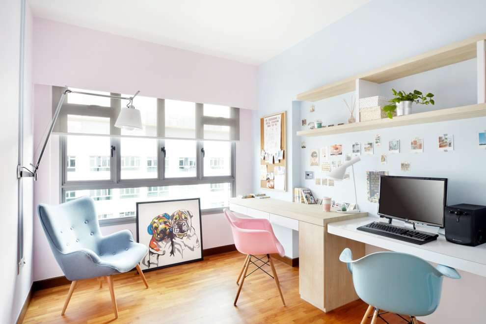 Home office - mid-sized scandinavian built-in desk medium tone wood floor home office idea in Singapore